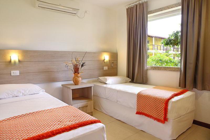 camas-solteiro-quarto-ar-condicionado