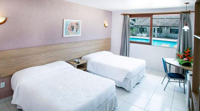Quarto Superior vista lateral com duas camas casal