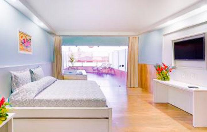 Suíte Premium com cama casal e televisão